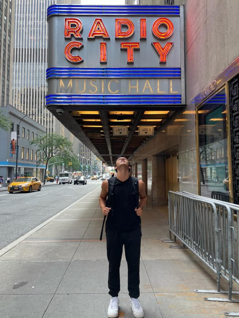 Konnor looking up at the Radio City Music Hall sign